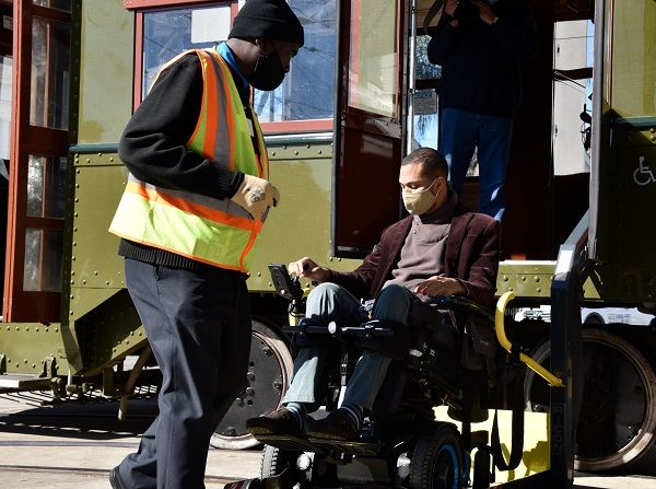 The agency'snew ADA compliant streetcars, equipped with wheelchair lifts, entered service on Dec. 1.Pictured here is RTA Streetcar Operator Terrence Anderson with RTA Vice Chairman, Mark RaymondJr. - New Orleans RTA