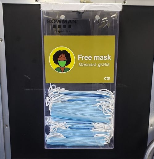 The disposable masks will be available from dispensers placed at the front of the bus, near where customers board. - CTA