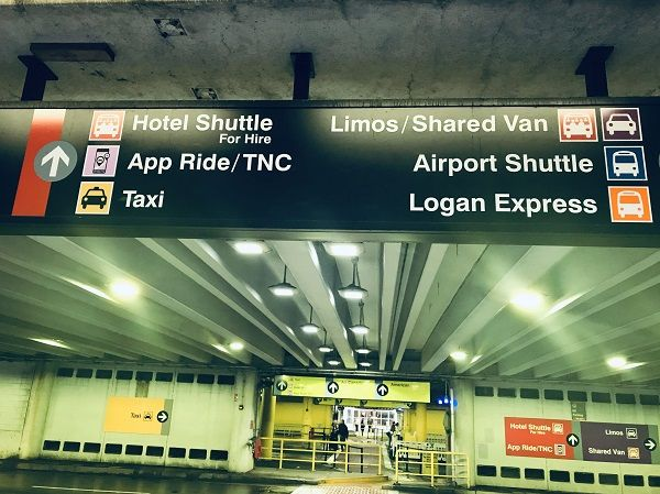 Boston's Logan Airport signage directs passengers to various transportation modes, including TNCs. - File photo