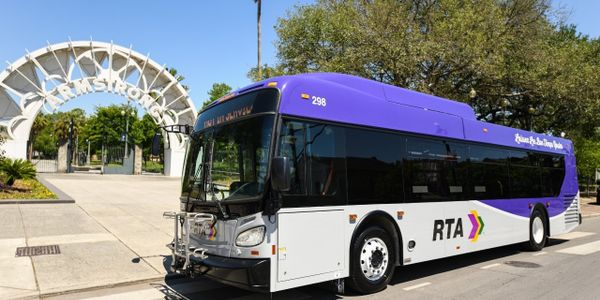 """The new purple and grey buses which don the phrase """"laissez les bons temps rouler,"""" were..."""