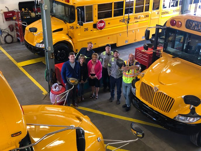 The first line of defense against COVID-19 is keeping the buses virus-free, which entails cleaning, sanitizing, and ventilation, says Bill Harvey, director of transportation and security for the Honeoye Falls-Lima Central School District. He is shown right with office and shop team members. - Photo courtesy Bill Harvey