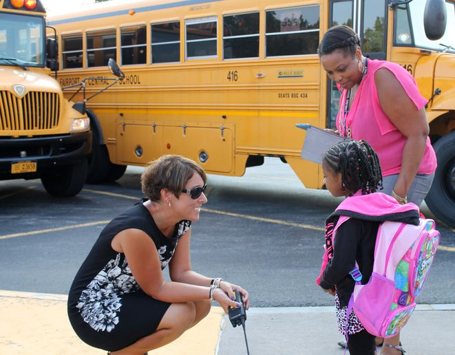 Administrators should be involved in the hiring process when a new director is being interviewed. Shown left is Amy Busby, the assistant principal of Jefferson Avenue School in Fairport, N.Y., talking to a student and parent. - Photo courtesy Fairport Central School District