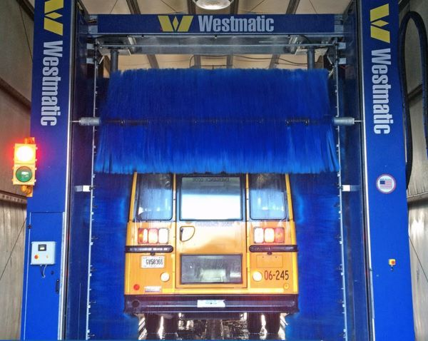 "The Westmatic two-brush rollover/gantry system's overlapping brushes are designed to thoroughly clean the rear of the bus (as shown here), eliminating the ""skunk stripe"" often seen on buses, while keeping rear windows clean. - Photo courtesy Westmatic"