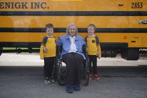 Jeanne Roenigk, the family matriarch and vice president of W.L. Roenigk Inc., continues to come to the office every day at 89. She is shown here with her twin grandsons, Colin and Caleb McClish. - Photo courtesy Josh Orris