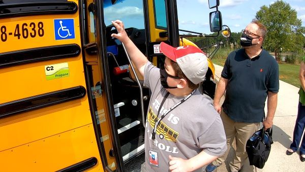 Student Jack Kendrick advocated for his school to add a propane bus to its fleet. He ended up getting one dedicated to him in a recent ceremony. He is shown here with his father. - Photo courtesy Greenville (S.C.) County Schools