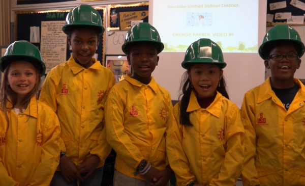 The Center for Transportation and the Environment works with school districts such as Stockton (Calif.) Unified School District (a few of its students are shown here) to find funding and implement the technical and outreach activities necessary for a successful switch to electric vehicles. - Photo courtesy The Center for Transportation and the Environment