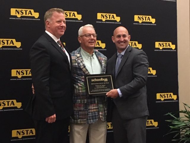 SBF is accepting nominations for the 2020 Contractor of the Year award. Seen here center is 2019 recipient Michael Wagner with National School Transportation Association Past President Blake Krapf (left) and SBF Associate Publisher Mark Hollenbeck (right). -