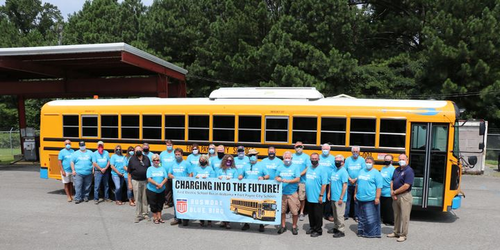 The buses are Blue Bird All American models, equipped with the Cummins 100% electric PowerDrive system, which produces zero emissions. - Blue Bird