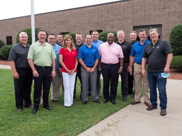 Seating safety product manufacturer IMMI has acquired SynTec Seating Solutions. Shown here are the leadership teams from the two companies. - Photo courtesy IMMI