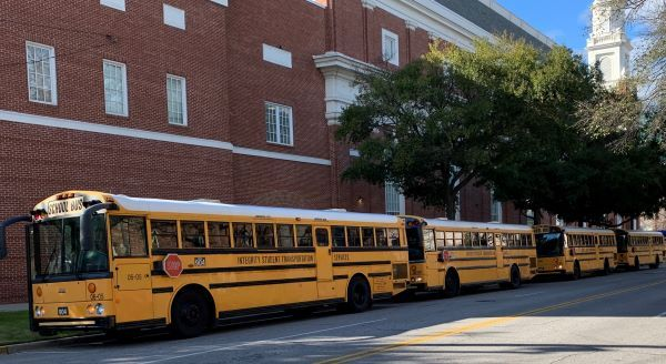 Integrity Student Transportation Services, which had been sidelined by the COVID-19 pandemic, gets buses back on the road after several months, transporting students to a swim meet. Shown here are some of the contractor's school buses. - Photo courtesy Integrity Student Transportation