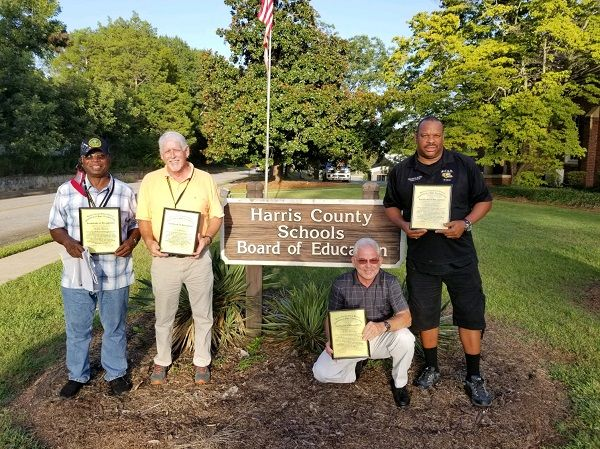 Pictured from left to right arefour Muscogee County (Ga.) School District drivers—Jimmie Harris, Ken Sherman, Jackie Hancock, and Marshall Archie—who were recognized by Harris County (Ga.) School District for stepping up to help transport students during a driver shortage. - Harris County School District