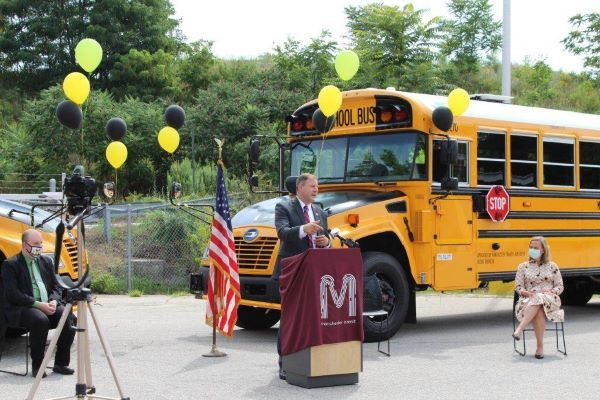 The City of Manchester (N.H.) added 14 Blue Bird Propane Vision buses to its fleet. Shown here is a ribbon-cutting sharing the news, which Gov. Chris Sununu (at podium) attended. - Photo courtesy Manchester Transit Authority