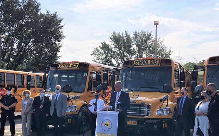 The New York Association for Pupil Transportation's (NYAPT's) coalition held an event to remind motorists to stop for a stopped school bus. Shown at the podium is Dave Christopher, executive director of NYAPT. - Photo courtesy NYAPT