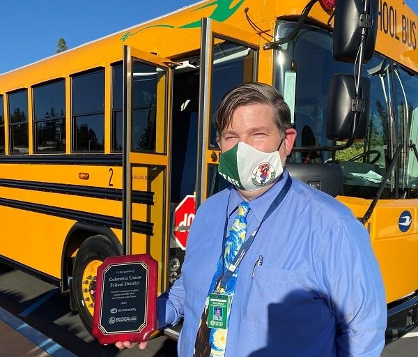 Shown here is Joe Aldridge, superintendent at Columbia Union School District, in front of one of the district's new Blue Bird electric buses. - Photo courtesy A-Z Bus Sales