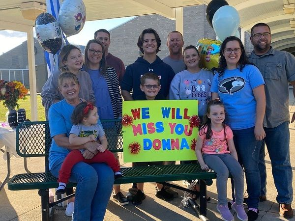Donna Channell, a longtime driver for Helena Intermediate School in Alabama (pictured front left), is recognized for her more than 30 years of service. She is shown here with her family. - Photo courtesy Helena Intermediate School