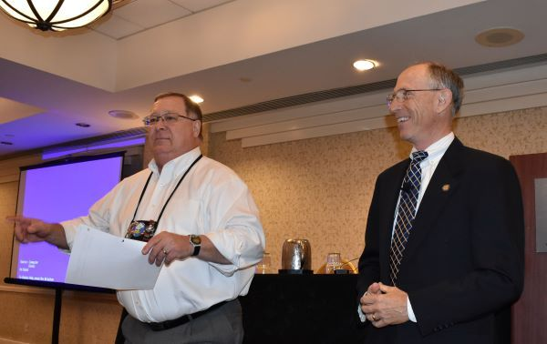The National Association of State Directors of Pupil Transportation Services (NASDPTS) is holding free virtual meetings in mid-November. Pictured here are NASDPTS President Mike LaRocco (left) and National Transportation Safety Board Vice Chair Bruce Landsberg at the association's 2019 conference in the Washington, D.C., area. -