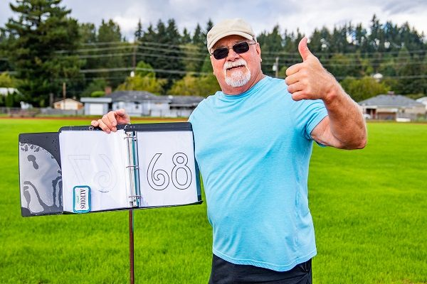 Ray Bartness of Longview Public Schools raised more than $3,000 for his fellow school bus drivers after conducting a walk-a-thon fundraiser. He walked a total of 68 laps. - Photo courtesy Michael Bartness Photography