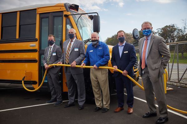 Thomas Built Buses is beginning delivery of its electric school buses in Virginia and marked the occasion at dealer Sonny Merryman's headquarters. Shown from left: Caley Edgerly, president and CEO of Thomas Built Buses; Dr. Jeff Cassell, superintendent of Waynesboro City Public Schools; Floyd Merryman, president and CEO of Sonny Merryman; Eric Reynolds, senior director of channel sales at Proterra; and Dan Weekley, vice president of energy innovation policy and implementation at Dominion Energy. - Photo courtesy Daimler Trucks North America