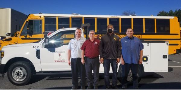 Gwinnett County (Ga.) Public Schools mechanic Calvin Cornelius (third from left) was assisted by...