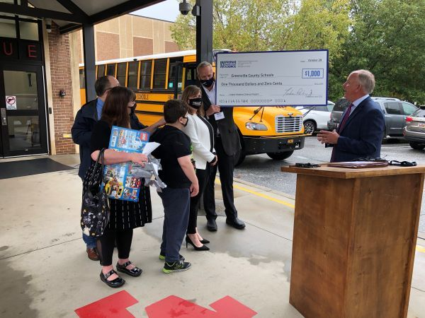 South Carolina seventh-grader Jack Kendrick (shown center) is honored by the Propane Education and Research Council (PERC) for getting his school to add a propane-powered bus designed for special-needs students to its fleet. Shown right presenting the award and a check for science programs at Kendrick's school is Tucker Perkins, PERC's president and CEO. - Photo courtesy Greenville County (S.C.) Schools