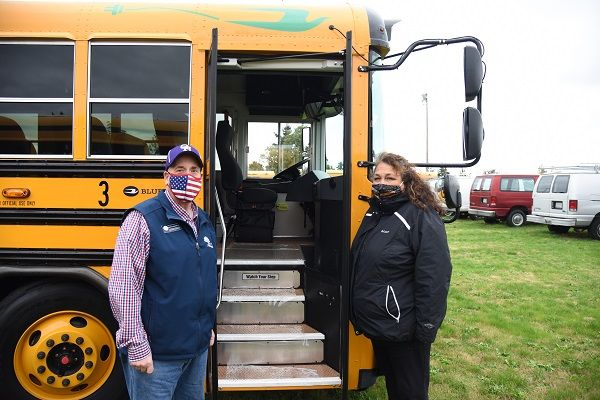 Oak Harbor (Wash.) Public Schools secured a Volkswagen settlement grant to purchase its first electric school bus. Shown here is Francis Bagarella, the district's transportation director, and Cathi Gutierrez, the district's assistant transportation director. - Photo courtesy Oak Harbor Public Schools