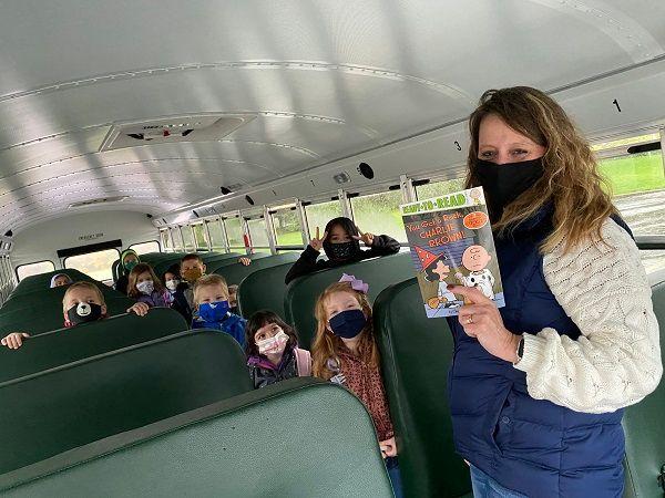Springboro (Ohio) Schools bus driver Karen Borgemenke takes a shorter route to school due to COVID-19 but uses the extra time to read to students. - Photo courtesy Scott Marshall, Springboro Schools