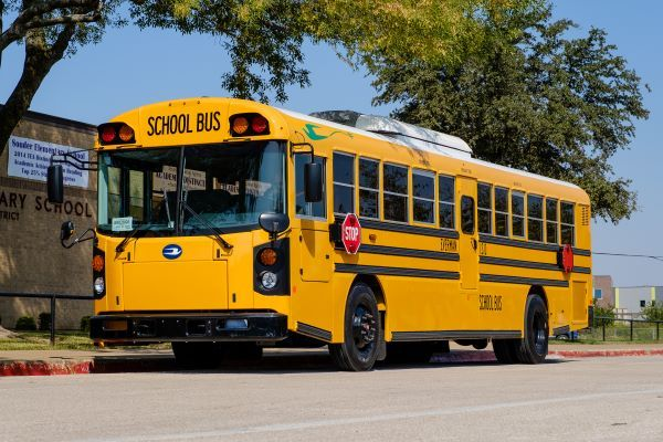 Everman (Texas) Independent School District added three Blue Bird Vision Electric school buses, the first to be deployed in the state, to its fleet.  - Photo courtesy Rush Enterprises