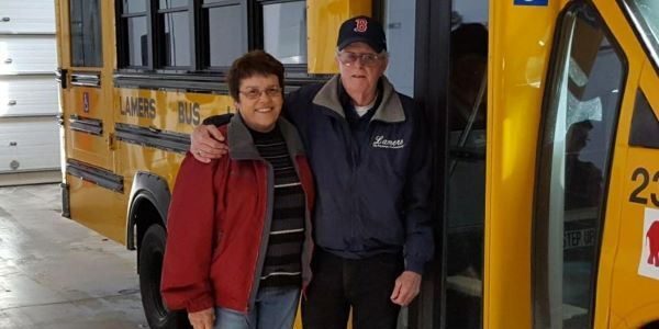 Jerry Davis, shown right with his wife Dixie Davis, retired after driving school buses for 53...