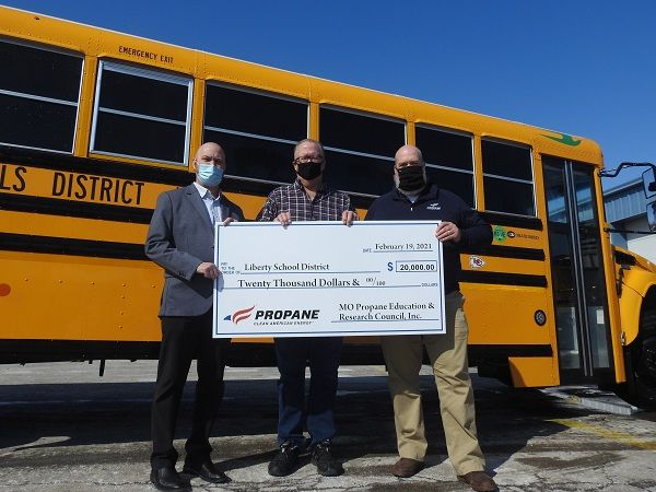 Liberty (Mo.) Public Schools received a $20,000 rebate from the Missouri Propane Education and Research Council (MOPERC) to purchase 10 Blue Bird Vision propane school buses. Pictured from left: Cliff Caton, Central States Bus; Jeff Baird, Liberty Public Schools transportation director; and Mark Porth, CHS Inc. and MOPERC chair. - Photo courtesy MOPERC