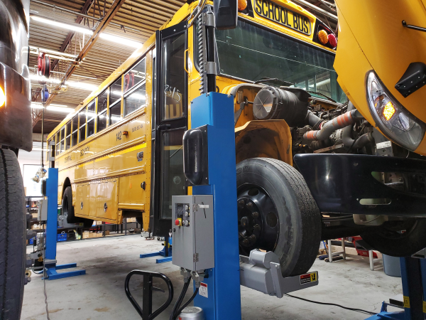 Amply Power and Unique Electric Solutions (UES) are partnering to repower internal combustion engine vehicles with V2G-capable electric powertrains. Shown here is a UES electric propulsion system repowering a school bus for New York-based Logan Bus Co. - Photo courtesy UES