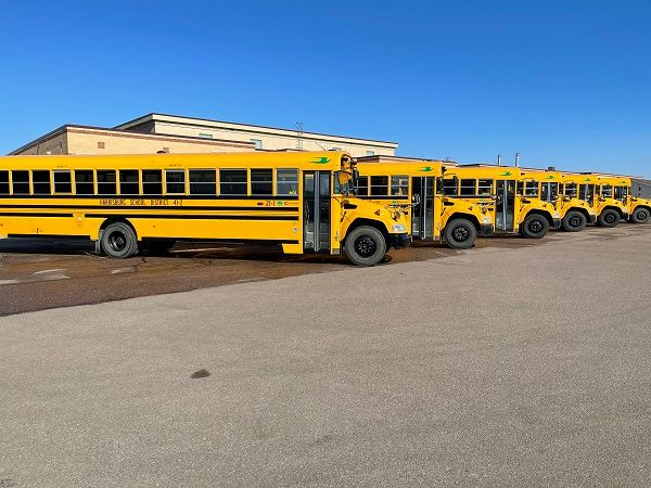 A total of six South Dakota school districts have received funding from the state'sDepartment of Environment and Natural Resources topurchaseBlue Bird Vision propane school buses. Shown here are six of Harrisburg School District'spropane buses. - Photo courtesy Roush CleanTech