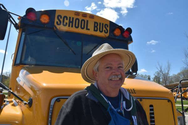 """CalAmp recently named its first ever """"Bus Guardian Hero,"""" awarding Tim Cribley from Hudsonville (Mich.) Public Schools for his commitment to student safety and work supporting local food banks. - Photo courtesy CalAmp"""
