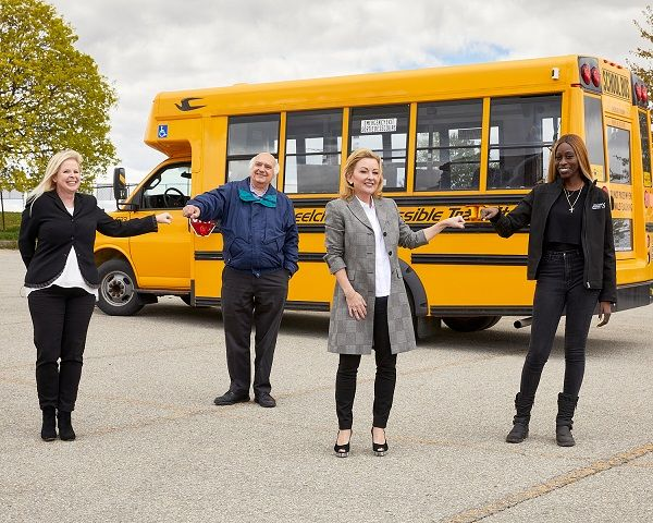 Toronto Student Transportation Group is working with Gatekeeper Systems Inc. and United Safety and Survivability Corp. to install safety solutions on some of its school buses. Shown here (from left to right): Patricia Turner, Gatekeeper's territory manager for Eastern Canada; John Hlady of Toronto Student Transportation Group; Heather Urquhart, Gatekeeper's director of marketing; and Natasha Campbell of Wheelchair Accessible Transit. - Photo courtesy Gatekeeper Systems Inc.