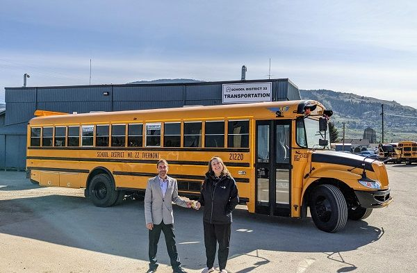IC Bus recently delivered its first electric CE Series school buses to school districts in British Columbia, Canada. Shown here is Joel Landry (left), account manager for IC Bus dealer Western Canada Bus, and Robyn Stephenson, manager of transportation services at School District No. 22 in Vernon, British Columbia. - Photo courtesy Navistar