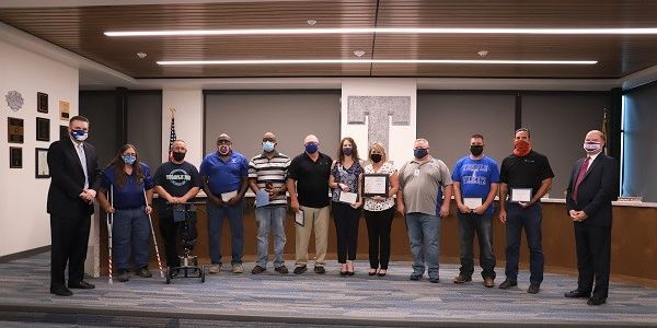 Ten members of the transportation team at Temple (Texas) Independent School District (ISD)...