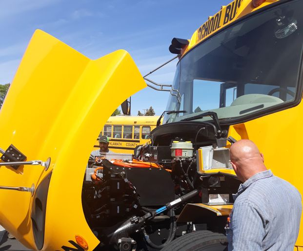 The Oregon-based Electric Bus Learning Project recently conducted what is reportedly the state's first-ever electric school bus tour. Shown here is a Klamath County School District bus mechanic checking out the LionC bus featured in the tour. - Photo courtesy Alison Wiley