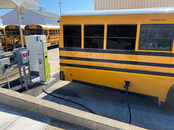 Nuvve Holding Corp.(Nuvve) is partnering with several school districts and utilities in California and Colorado to accelerate the electrification of their school bus fleets. Shown here is a Nuvve DC vehicle-to-grid charging station from Rhombus Energy Solutions charging a Blue Bird electricschool bus. - Photo courtesy Nuvve Holding Corp.
