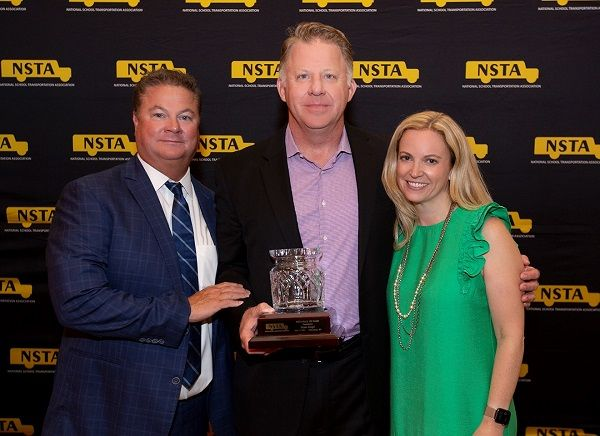 Blake Krapf (center) of Krapf School Bus in West Chester, Pennsylvania, was inducted into the National School Transportation Association's (NSTA's) Hall of Fame. He is pictured here with outgoing NSTA president John BenishJr. of Cook-Illinois Corp. (left) andincoming NSTA president Carina Noble of National Express. - Photo courtesy NSTA