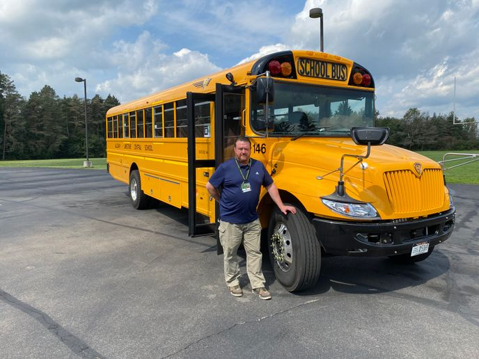 Shawn Phinney,the transportation supervisor for Allegany‐Limestone Central School District, is pictured here with one of the new buses thatfeaturecollision mitigation andelectronic stability control systemsand Wi-Fi. - Photo courtesyAllegany‐Limestone Central School District