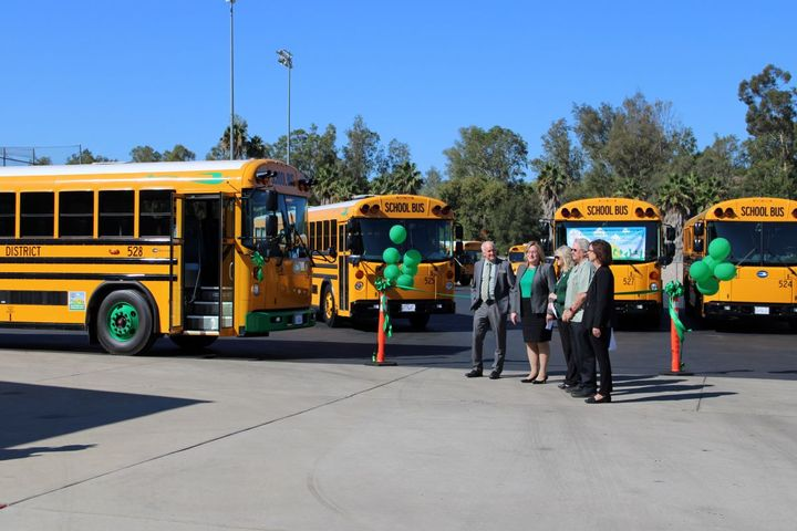Officials from the Escondido Union High School District in California celebratethe rollout of six new electric buses. - Photo courtesy Escondido Union (Calif.) High School District