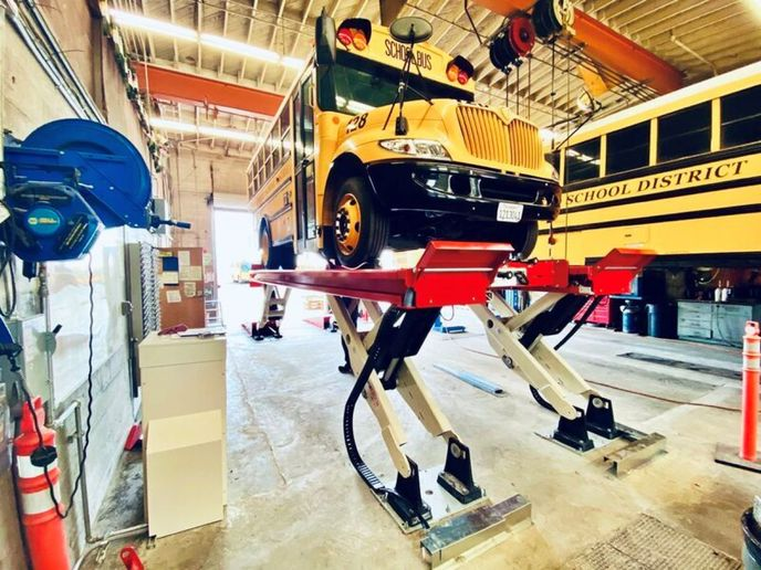 The Stertil-Koni SKYLIFT platform gives access to the center frame rails of a raised electric school bus, where battery packs and drive motors can be found. - Photo courtesy of Stertil-Koni