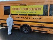 Many school districts deployed drivers, armed with protective gear, for delivery service to keep...