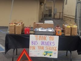 Alhambra (Calif.) Unified School District hosted a drive-by parade,handing out pizza, hot dogs,...