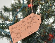 """On a more serious note, Mitchell added, the department's """"Thankful Tree,"""" which is adorned with..."""