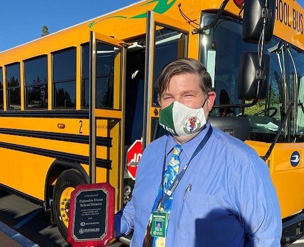 Joe Aldridge, superintendent at Columbia (Calif.) Union School District, posed in front of one...