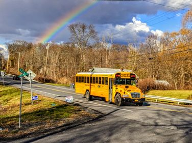 A sign of hope: Clarence Mow, a school bus driver for The Mount Academy in Esopus, New York, was...