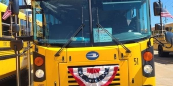 Markie Bibb's Bus No. 51 bears red, white, and blue bunting in honor of Lance Cpl. Jared Schmitz.