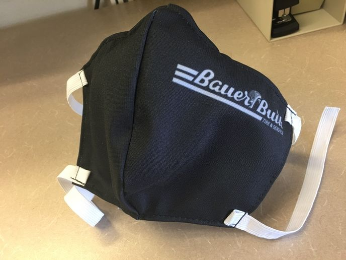 Bauer Built ordered masks for its employees, but Jerry Bauer knew that white masks would get dirty quickly. When he inquired about having them dyed black, he learned it wouldn't be any more expensive to add the company name and logo to the design. -