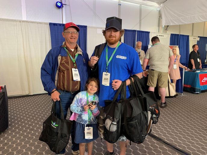 Three generations of the Gehrke family were collecting freebies from vendors during the Point S trade show to take back to the team at Hermiston Point S in Hermiston, Ore.: Merle, (left) with Austin (right) and granddaughter Trinity. -
