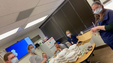 Nurses enjoy donated meals that Christie Stock and her employees purchased from local...